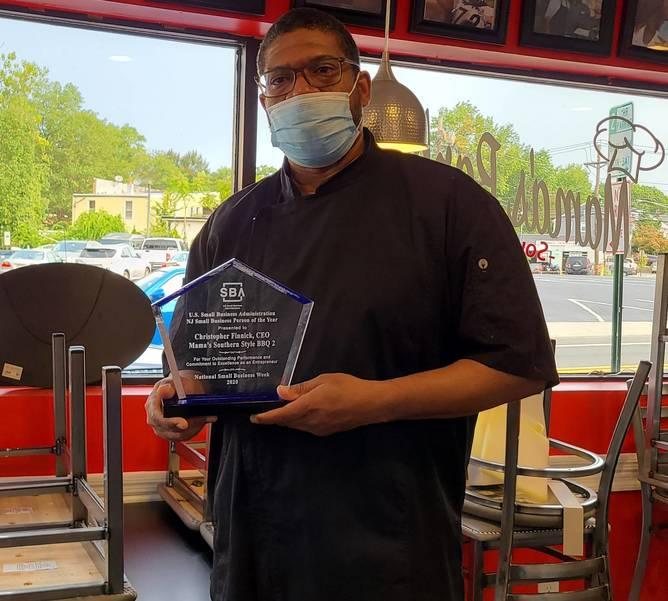 Chris Finnick with Award 4 (1).jpg