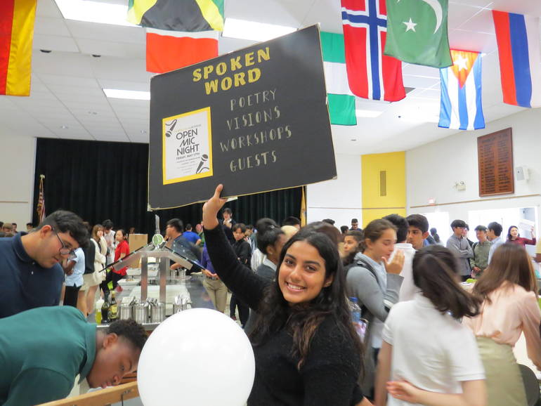Rose Kassam of Scotch Plains recruits students to join Spoken Word at the Clubs Fair.