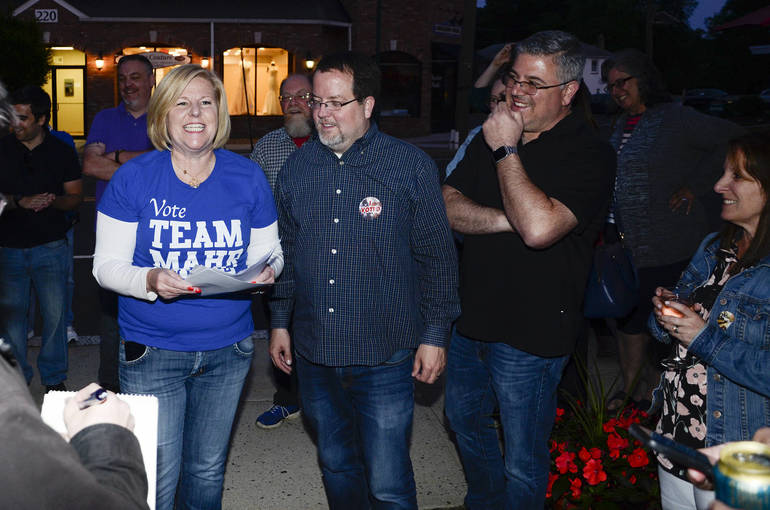 Fanwood Mayor Colleen Mahr reads results with Fanwood Democratic Chair and Council candidate Kevin Boris and Jeff Banks
