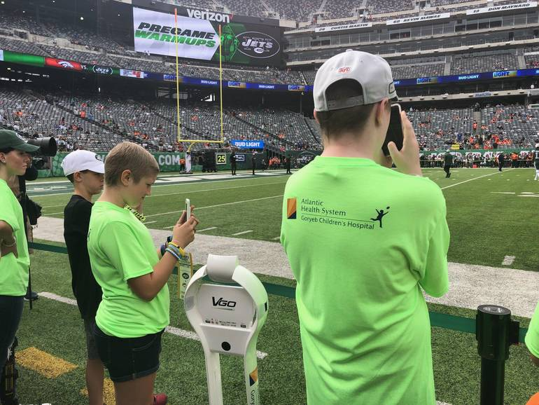 Honorary Captains from Goryeb Children's Hospital with the VGo Robot on the Sideline