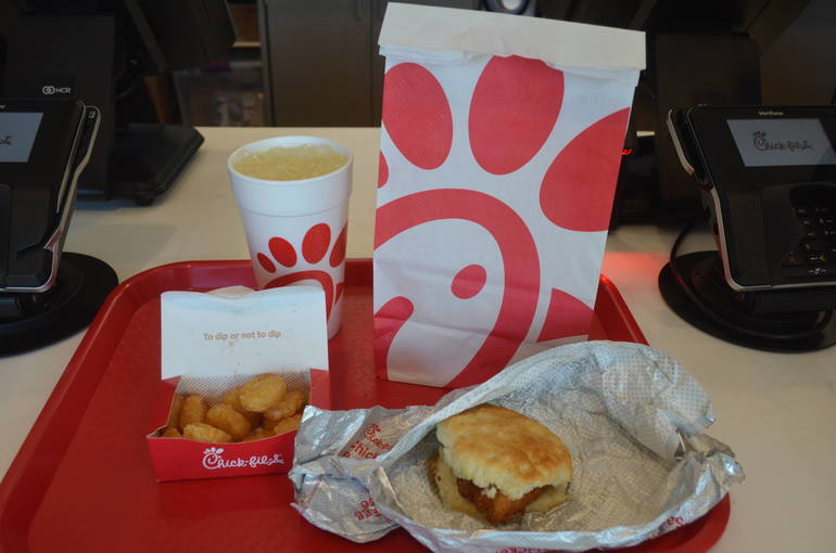Chicken and biscuit, hash browns, and lemonade at Chick-fil-A.
