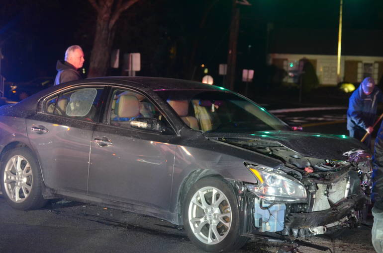 A car is towed away after a crash near Fanwood train station on Tuesday, Jan. 21, 2020.