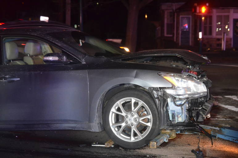 A vehicle involved in the crash is towed away from the Fanwood train station on Tuesday, Jan. 21, 2020.
