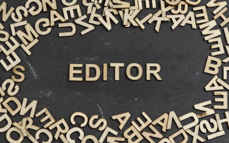 Editor word built with wooden letters