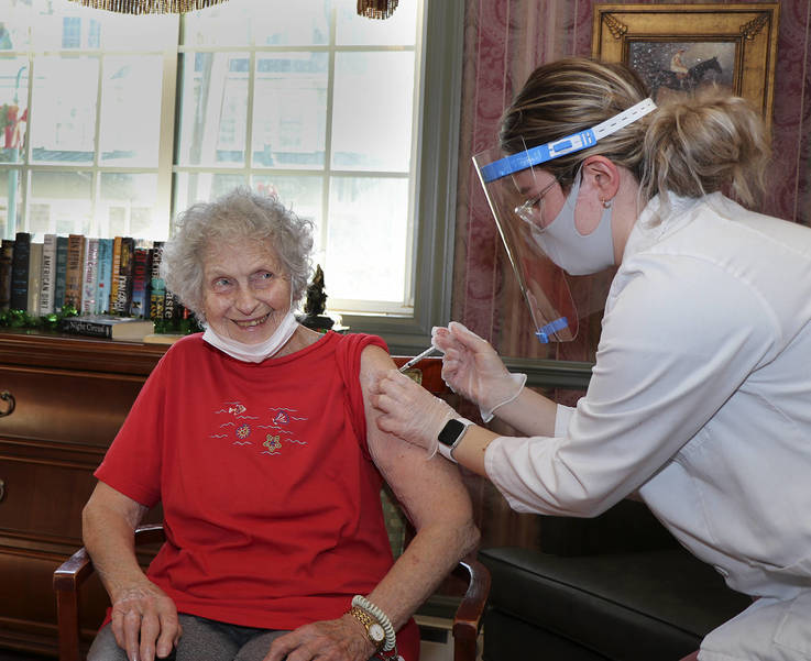 Eileen Marino, a Chelsea Senior Living resident in Fanwood, receives the COVID-19 vaccine on Thursday, Jan. 7, 2021.
