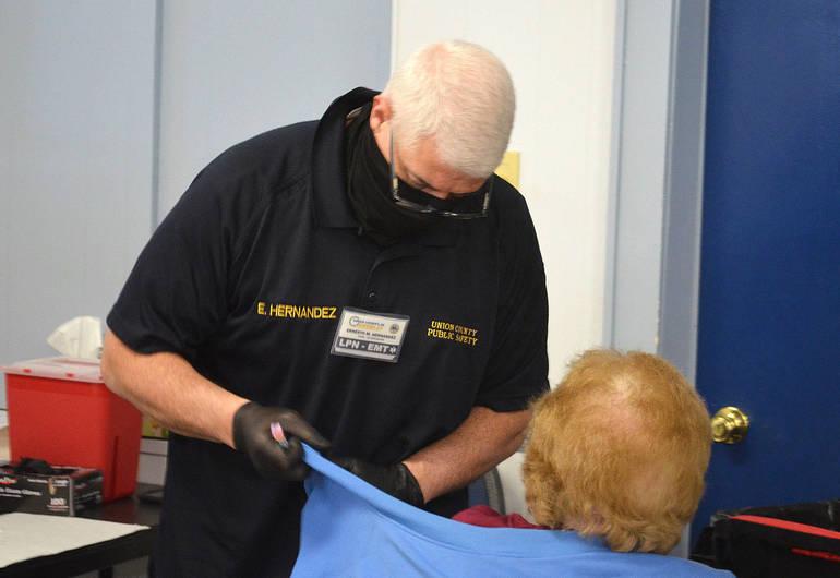 Ernie Hernandez vaccinates a senior at St. John's Baptist Church in Scotch Plains.