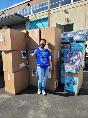 Zeta Phi Beta Sorority members fill a Uhaul with donations  for Moms Helping Moms!