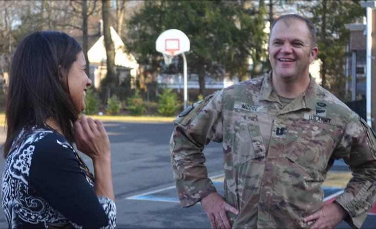 Fanwood residents Michele and Patrick Moore celebrate his return from reserve duty for the first time in a year.png