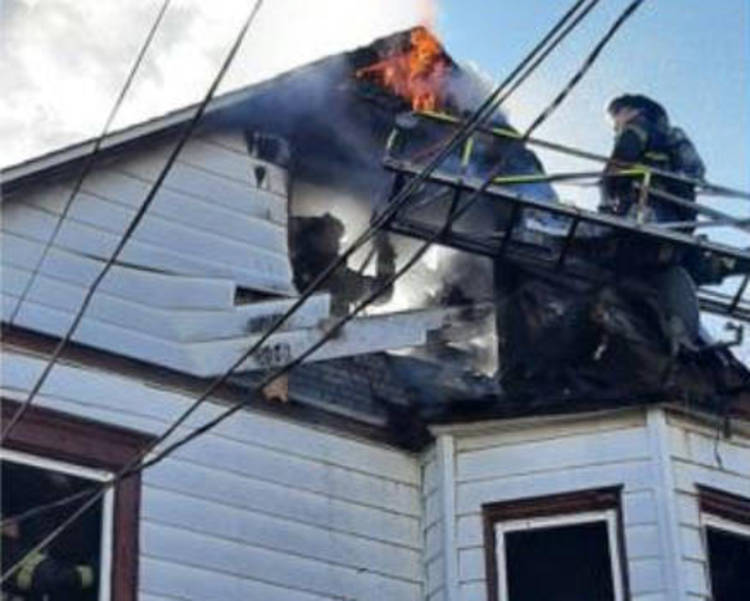 Woman Injured After Jumping From Roof During House Fire