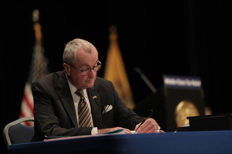 Gov. Murphy signs the budget.jpg