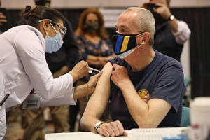 A masked Gov. Murphy was vaccinated earlier this year.