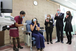 Carousel image c71f9d5eedd58ebc4441 19cc1032a29be9340629 healthcare worker gets vaccinated gov. phil murphy s office