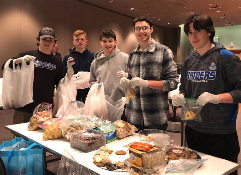 Scotch Plains-Fanwood High School ice hockey team made sandwiches at Temple Emanu-El in Westfield to help feed the homeless.