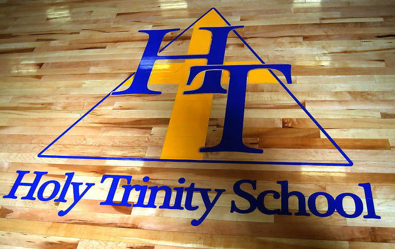 Holy Trinity logo on gym floor.png