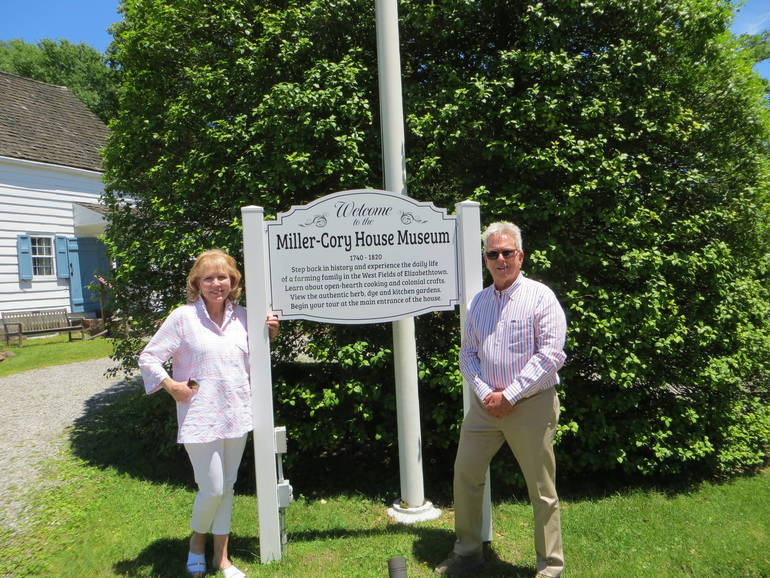 Ms. Sharon Sullivan & Mr. Harold Struck in front of new museum welcome sign.