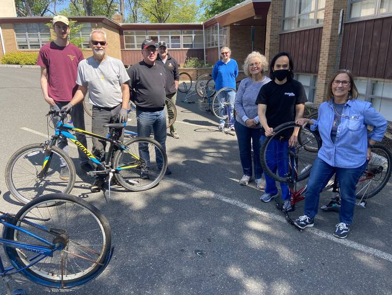 Members of Clark's Osceola Church Join Fellow Church in Repairing Over 400 Bikes for Charity