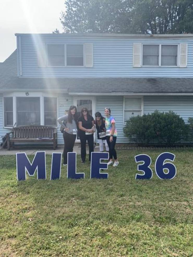 Kathy in front of her childhood home in Edison with her sister and niece