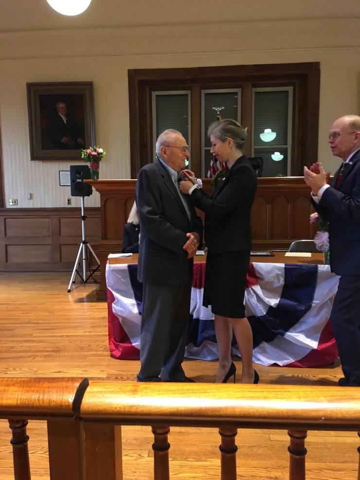 Paller receives the medal.