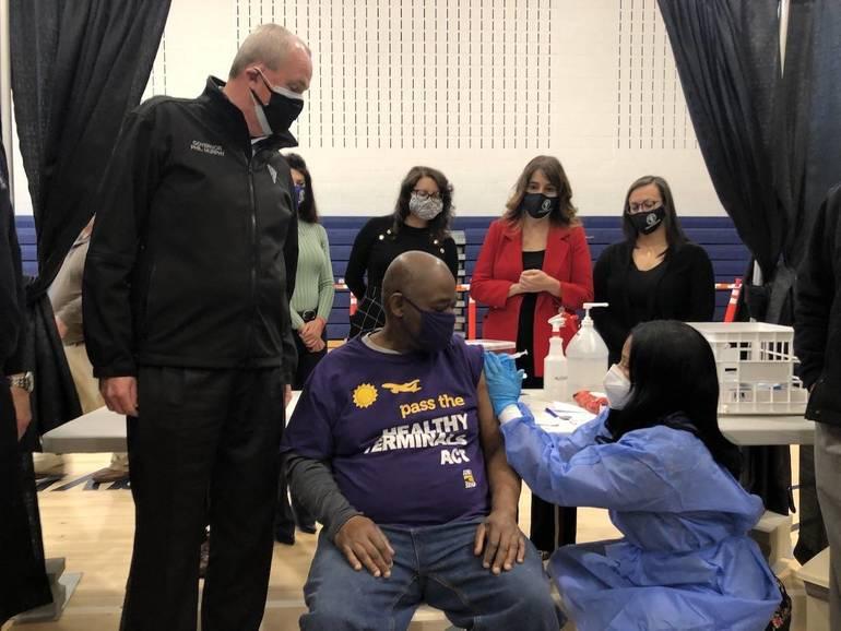 Newark Airport worker receives vaccination