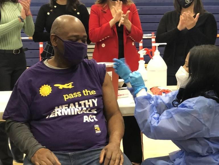 Airport worker receives vaccine