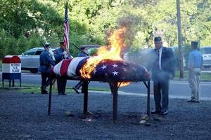 Burning American Flag on a Pyre
