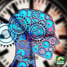 Mental Health Awareness Month. Image shows a drawing of a head with gears overlaying a clock.