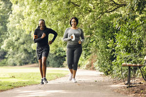 Two women running in the park.