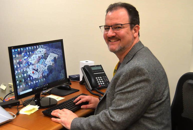 JCC CEO Mike Goldstein at desk.png
