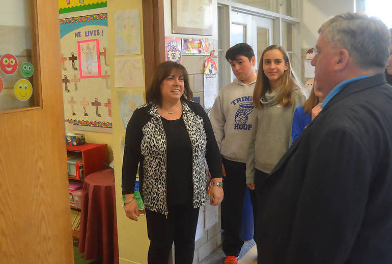 Joe Nolan looks into his former religion classroom.png
