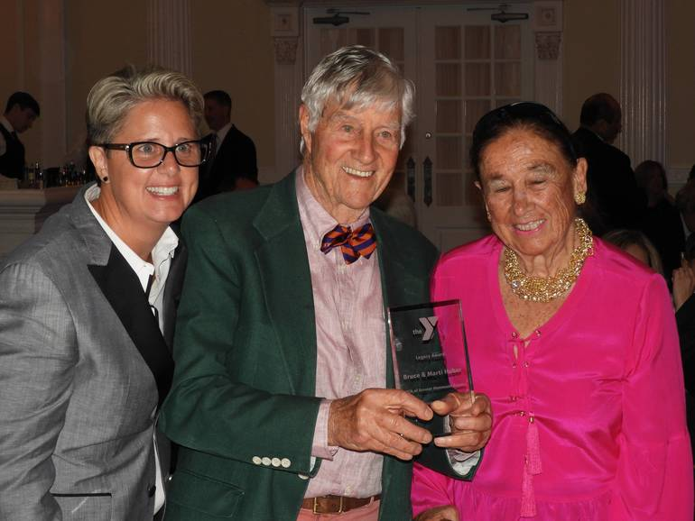Laurie Goganzer, President & CEO of the YMCA with Bruce and Marti Huber, recipients of the Legacy Award Award.jpg