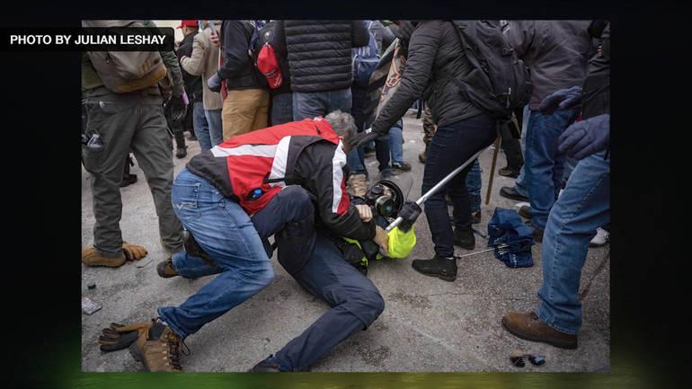 MAGA Rioter tackles Policeman