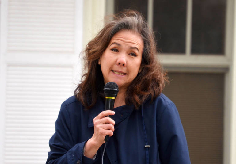 Local resident Lorraine Schug spoke at the Stop Asian Hate Rally during the open mic session.