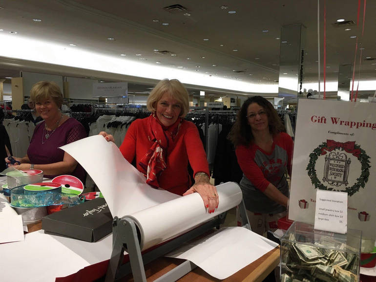 L&T Gift Wrapping volunteers.gif