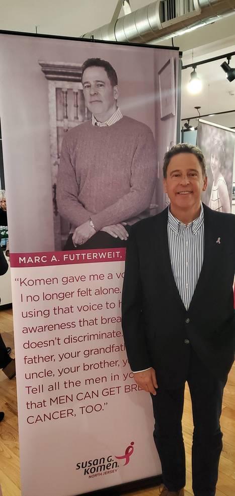 Marc A. Futterweit Standing Next to His Story.jpg