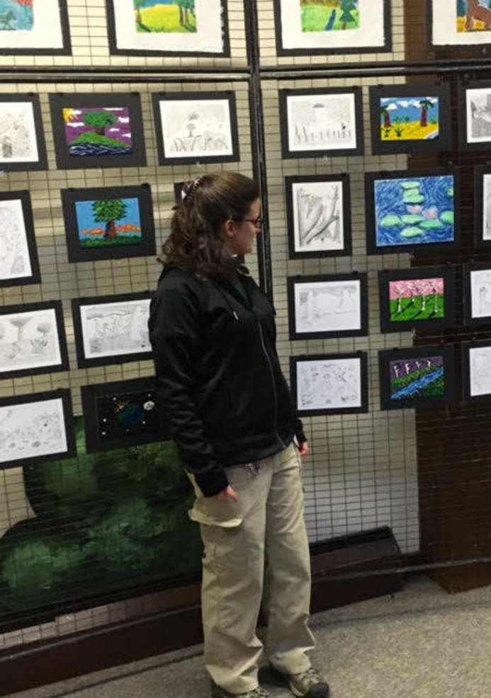 EEC Naturalists Vanessa Darras with artwork from Somerset Hills students