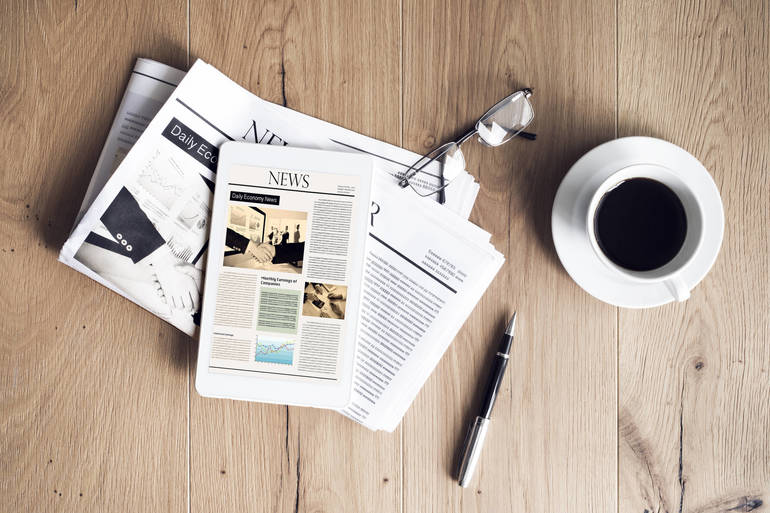 News on Tablet with Coffee