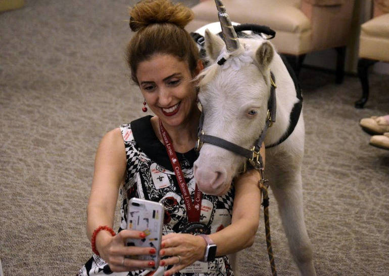 Noble the Unicorn poses for a selfie while visiting The Chelsea at Fanwood on Friday.