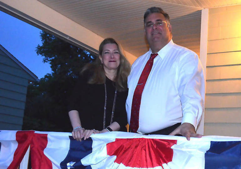 Phyllis and Al Mirabella on their front porch in Fanwood.png