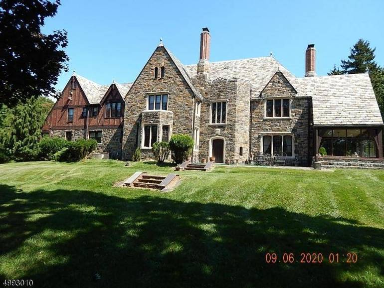 This spectacular Tudor home was custom-built in 1930 on 2.7 acres in Plainfield. It lists for $1 million.