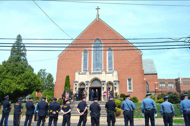 Prenti - Police line up outside church in Plainfield.png