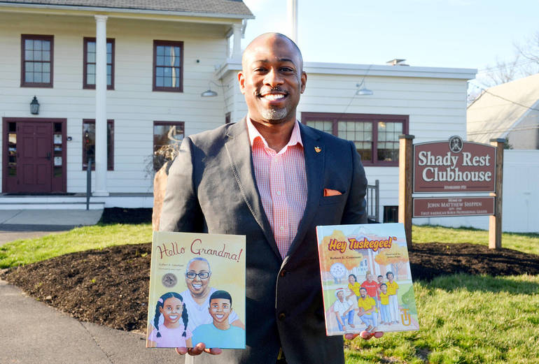 Robert Constant with hisbooks, Hello Grandma! and Hey Tuskegee, at the historic Shady Rest Clubhouse at Scotch Hills Country Club in Scotch Plains.