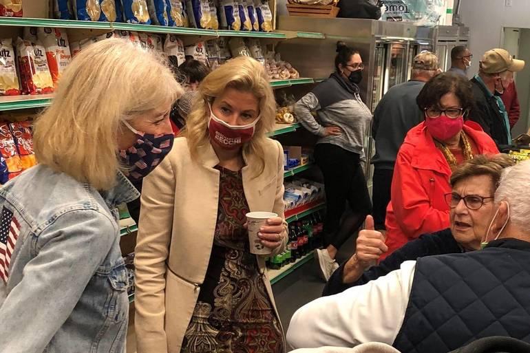 Rosemary Becchi speaks to voters over breakfast in Madison.jpg