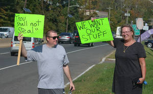 Robert Giulio of Linden and Mary Jean Murphy of Scotch Plains protest outside Public Storage on Route 22.