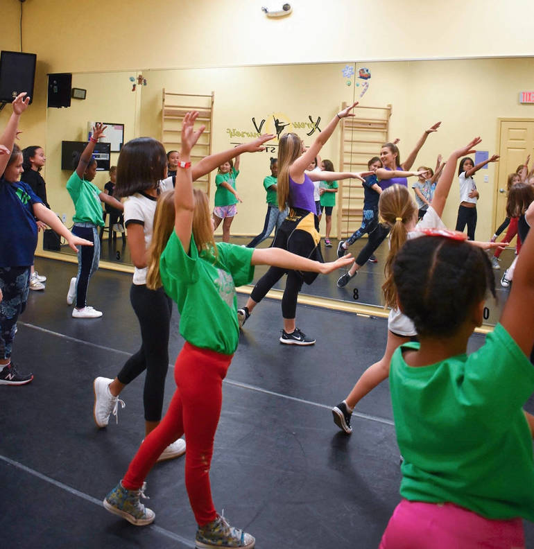 Alana Scheuerer, at the front, teaching a dance class to a group from the Girls Scouts.