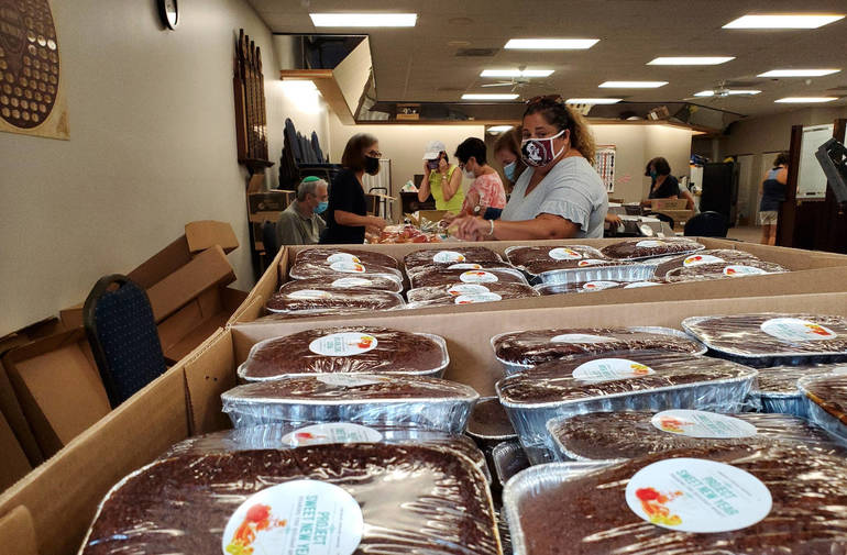 Dozens Gather To Make 1,000 Rosh Hashanah Bags For Local Residents