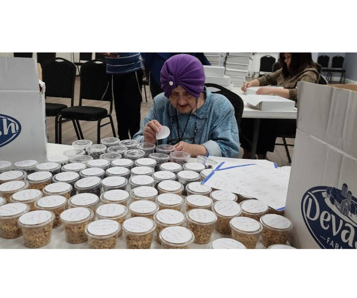 Holocaust Survivor Volunteers at Local Food Pantry