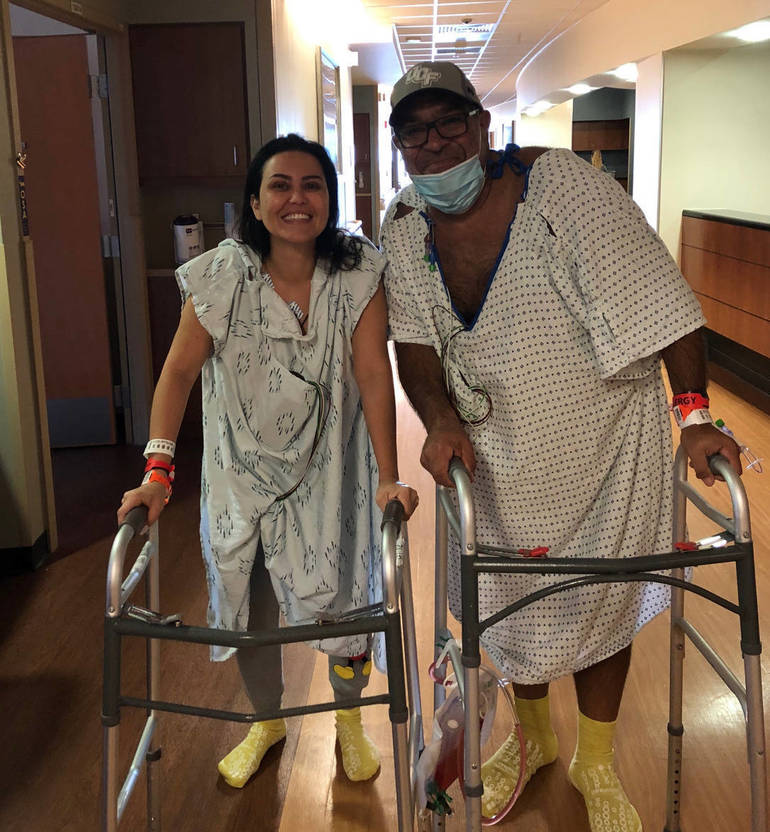 After surgery, Brunna Martins, left, with Frank Molino.