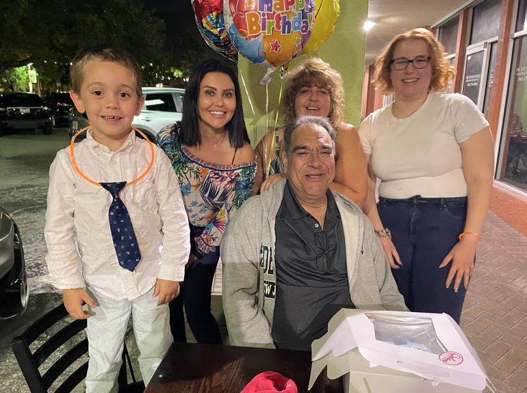 The families of Brunna Martins and Frank Molino celebrating Molino's birthday.