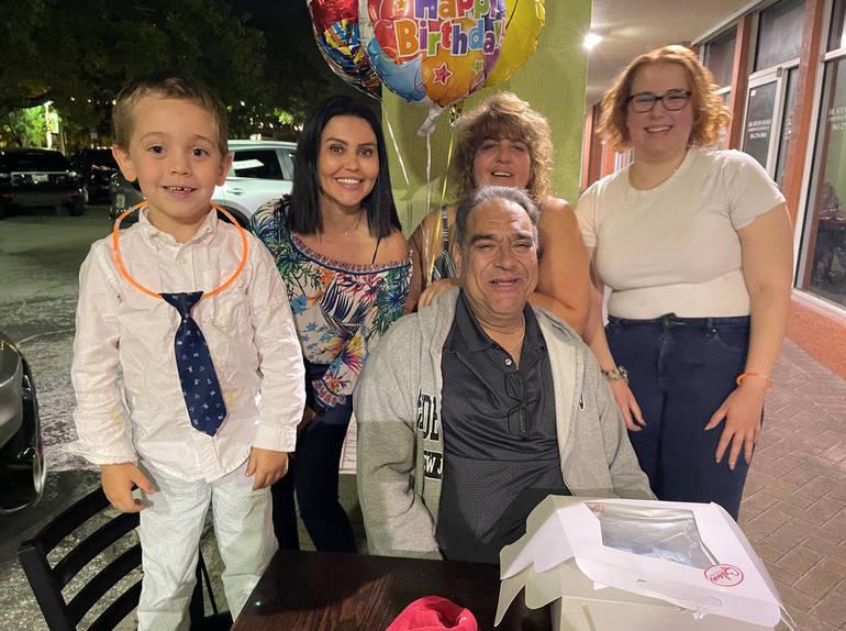 The families of Brunna Martins and Frank Molino celebrating Molino's birthday.