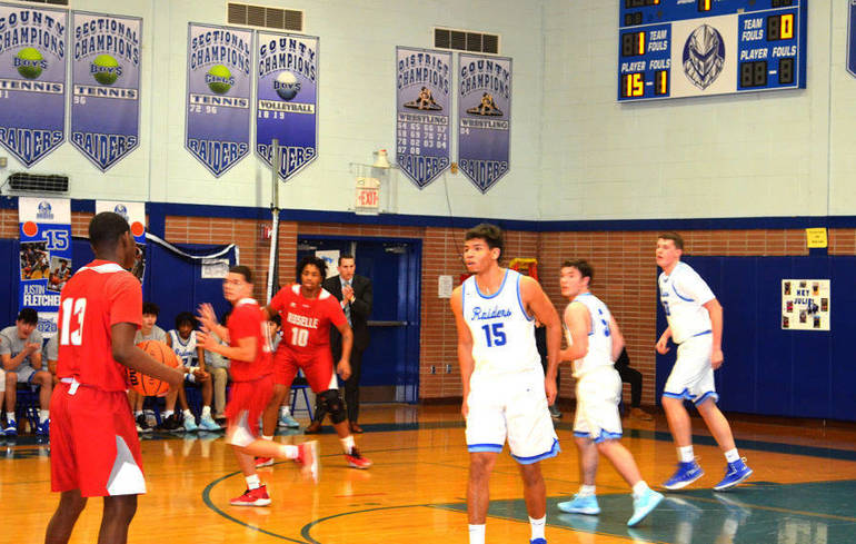 Scotch Plains-Fanwood's Justin Fletcher (15), Charlie Levine (5), and Dean Johnston (30) play defense in the first quarter..png